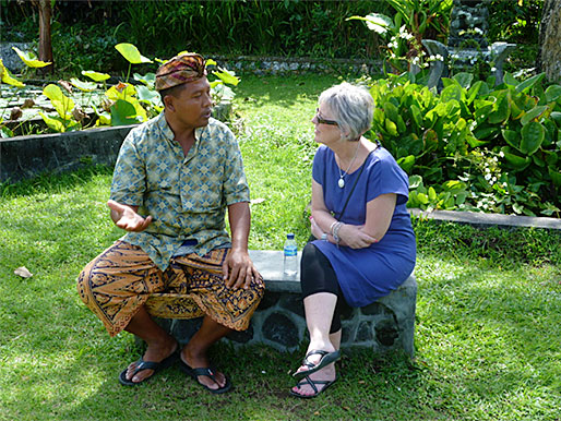 Louise speaking with man in Bali
