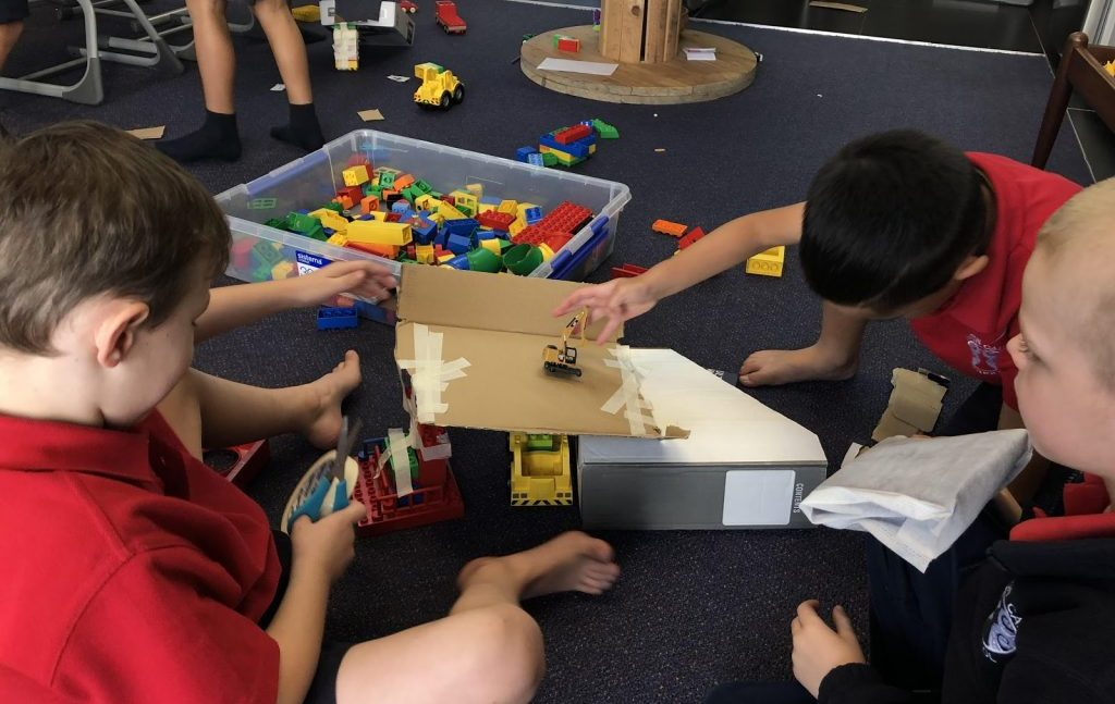 Juniors science collaboration - learning about simple machines. These photos were of groups of 3 or 4 students working collaboratively to create an inclined plane car ramp